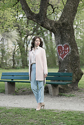Mature woman waiting for her date at park bench, Bavaria, Germany