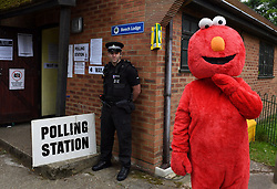 Police and a man dressed as Elmo outside a polling station in the village of Sonning, Berkshire, where Prime Minister Theresa May and her husband Philip are expected to cast their votes later.