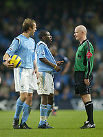 11/12/2004 - FA Barclays Premiership - Manchester City v Tottenham Hotspur - The City of Manchester Stadium.<br />Manchester City's Shaun Wright-Phillips and Paul Bosvelt argue with referee Dermot Gallagher<br />Photo:Jed Leicester/Back Page Images