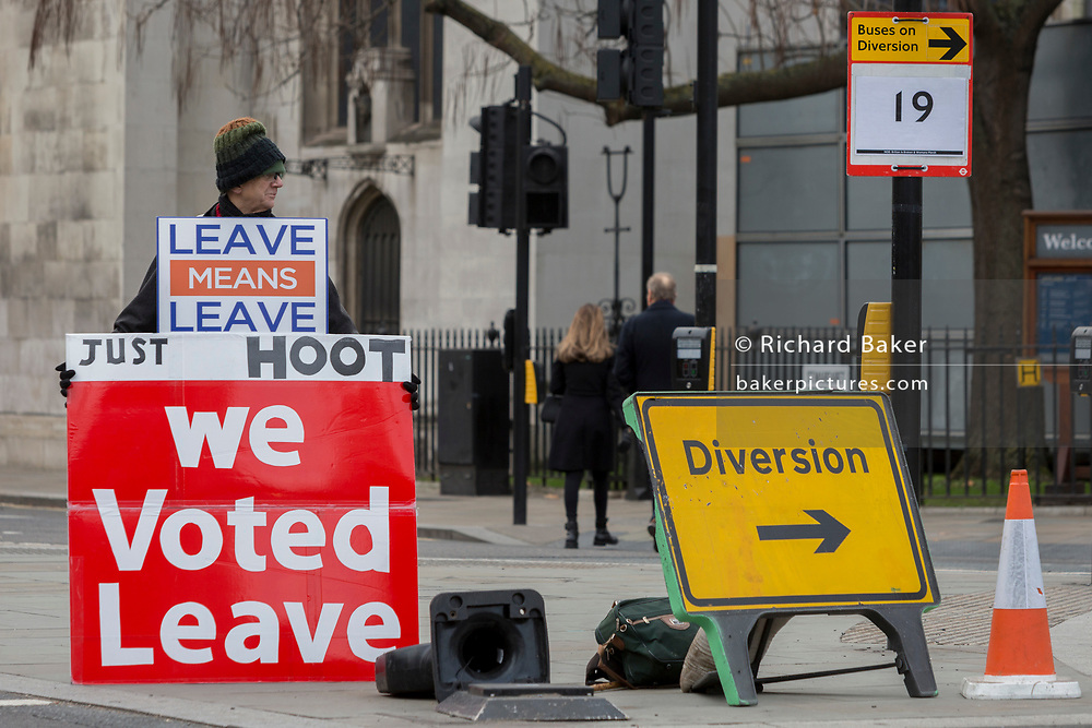 A pro-Brexiter protestor at the junction of Parliament Square in a week that Prime Minister Theresa May asks for MPs to back her Brexit deal, on 14th January 2019, in Westminster, London, England.