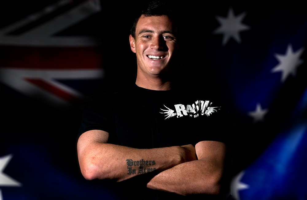 August 24, 2010: Dane Pioli poses for photos in front of the Austrailian Flag in Coolangatta, Gold Coast, Queensland on 24 August, 2010. Photo By Matt Roberts