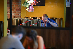 © Licensed to London News Pictures. 04/07/2020. London, UK. People are seen enjoying a drink at The Ice Wharf pub at Camden Lock, North London as Pubs, bars, cafes and restaurants are allowed to fully open for the first time since lockdown. Photo credit: Ben Cawthra/LNP