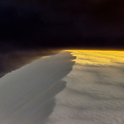 Dramatic sunset light on the dunes with  blowing sand, White Sands National Monument, New Mexico