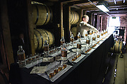 Chris Morris, the second Master Distiller at the Woodford Reserve Distillery, sets up a bourbon-tasting in one of the stone rickhouses on their property in Woodford County in Versailles, Ky. (Photo by Brian Bohannon)