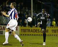 Photo: Chris Ratcliffe.<br /> Colchester United v Swansea City. LDV Vans Trophy. 14/03/2006.<br /> Leon Knight (R) of Swansea shoots for goal as Liam Chilvers takes evasive action