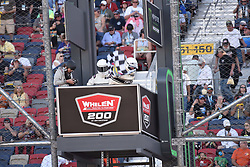 November 10, 2018 - Phoenix, Arizona, U.S. - PHOENIX, AZ - NOVEMBER 10:  NASCAR officials waves the checkered flag signaling the end of the race at the NASCAR Xfinity Series Playoff Race - Whelen 200  on November 10, 2018 at ISM Raceway in Phoenix, AZ.  (Photo by Lyle Setter/Icon Sportswire) (Credit Image: © Lyle Setter/Icon SMI via ZUMA Press)