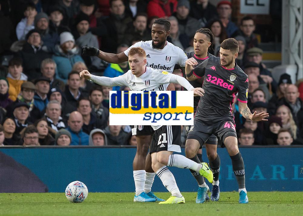 Football - 2019 / 2020 Sky Bet (EFL) Championship - Fulham vs. Leeds United<br /> <br /> Harrison Reed (Fulham FC) escapes the attentions of Mateusz Klich (Leeds United) at Craven Cottage<br /> <br /> COLORSPORT/DANIEL BEARHAM