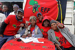 Wednesday 8th May 2019.<br /> Monwabisi Park, Harare,<br /> Khayelitsha, Cape Town, <br /> Western Cape, <br /> South Africa.<br /> <br /> SOUTH AFRICAN GENERAL ELECTIONS 2019!<br /> <br /> SOUTH AFRICAN PROVINCIAL AND NATIONAL ELECTIONS 2019! <br /> <br /> EFF supporters pose for a photo together outside the voting station at Monwabisi Park, Harare in Khayelitsha near Cape Town, Western Cape, South Africa.<br /> <br /> Registered South African Voters head to the various IEC (Independent Electoral Commission) Voting Stations where they are registered to vote as they cast their votes and take part in voting and other activities on Voting Day 8th May 2019 during the South African General Elections 2019. Voters from across the nation stood in queue's along with many others to vote in the Provincial and National Elections being held in South Africa on Wednesday 8th May 2019.   <br />  <br /> Copyright © Mark Wessels. All Rights Reserved. No Usage Without Permission.<br /> <br /> PICTURE: MARK WESSELS. 08/05/2019.<br /> +27 (0)61 547 2729.<br /> mark@sevenbang.com<br /> studioseven@mweb.co.za<br /> www.markwesselsphoto.com
