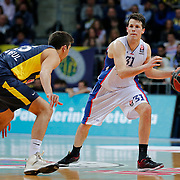 Anadolu Efes's Thomas Heurtel (R) during their Turkish Airlines Euroleague Basketball Top 16 Round 14 match Fenerbahce Ulker between Anadolu Efes at the Ulker Sports Arena in Istanbul, Turkey, Thursday 09 April, 2015. Photo by Aykut AKICI/TURKPIX