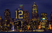 Lights in a building in downtown Seattle stand out on the Seattle skyline, showing support for the 12th Man: fans of the Seattle Seahawks.<br />