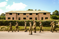 Army cadets walk past old council houses in Imber village on Salisbury Plain, Wiltshire, where residents were evicted in 1943 to provide an exercise area for US troops preparing to invade Europe. Roads through the MoD controlled village are now open and will close again on Monday August 22.