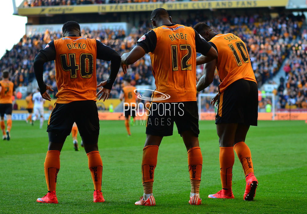 Benik Afobe, Bakary Sakho and Nouha Dicko celebrate the third goal during the Sky Bet Championship match between Wolverhampton Wanderers and Leeds United at Molineux, Wolverhampton, England on 6 April 2015. Photo by Alan Franklin.