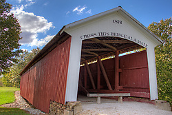 06 October 2013:   The Hillsdale Covered Bridge, also known and Possum Bottom or Jackson's Ford Covered Bridge, originally crossed the Little Raccoon Creek Vermillion County. This single span Burr Arch Truss structure has a length of 104 feet, or 124 feet including the 10-foot overhang at each end, with a portal clearance 13 feet 6 inches wide by 12 feet high. Built in 1876 by Joseph J. Daniels, The Hillsdale Covered Bridge was move to its present location in 1973, becoming the centerpiece of the Ernie Pyle Rest Park on State Road 36 in Section 35, Township 16 North, and Range 10 West, east of Dana, Vermillion County.<br /> <br /> Parke County Indiana is the site of the Indiana Covered Bridge Festival every October<br /> <br /> This image was produced in part utilizing High Dynamic Range (HDR) processes.  It should not be used editorially without being listed as an illustration or with a disclaimer.  It may or may not be an accurate representation of the scene as originally photographed and the finished image is the creation of the photographer.