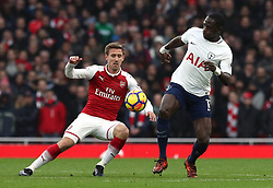 Arsenal's Nacho Monreal (left) and Tottenham Hotspur's Moussa Sissoko battle for the ball during the Premier League match at the Emirates Stadium, London.
