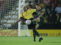 Photo: Paul Thomas.<br /> Watford v Norwich. Coca Cola Championship.<br /> 13/09/2005.<br /> <br /> Norwich's Jason Shackell clears the ball from Marlon King.