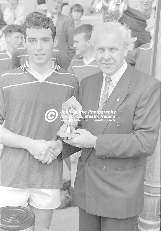 24-08-1991. Kilcloon/Moynalvey v Seneschalstown/Duleek - Meath MFC Final at Pairc Tailteann, Navan.<br /> Johnny Sullivan, Chairman, Meath Minor Football presenting the Player of the Match award to Cathal Sheridan.<br /> Photo: John Quirke / www.quirke.ie<br /> ©John Quirke Photography, 16 Proudstown Road, Navan. Co. Meath. (info@quirke.ie / 046-9028461 / 087-2579454).
