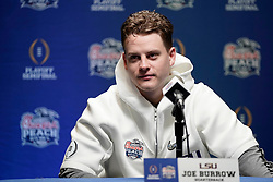 Joe Burrow #9 of the LSU Tigers speaks with the media at Media Day on Thursday, Dec. 26, in Atlanta. LSU will face Oklahoma in the 2019 College Football Playoff Semifinal at the Chick-fil-A Peach Bowl. (Paul Abell via Abell Images for the Chick-fil-A Peach Bowl)