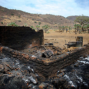 April 29, 2012 - Al Kanyard, Nuba Mountains, South Kordofan, Sudan: General view of a an house destroyed by Sudan's Army warplanes in the village of Al Kanyard. Two children and an adult died during the bombardments and other three suffered severe burn injuries. Since the 6th of June 2011, the Sudan's Army Forces (SAF) initiated, under direct orders from President Bashir, an attack campaign against civil areas throughout the South Kordofan's province. Hundreds have been killed and many more injured. Local residents, of Nuba origin, have since lived in fear and the majority moved from their homes to caves in the nearby mountains. Others chose to find refuge in South Sudan, driven by the lack of food cause by the agriculture production halt due to the constant bombardments of rural areas.