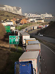 © Licensed to London News Pictures. 18/12/2020. Dover, UK. Trucks queue up on the A20 to get to the Port of Dover. Retailers are suggesting that delays at some ports are causing shortages of goods in the shops this Christmas. Photo credit: Peter Macdiarmid/LNP
