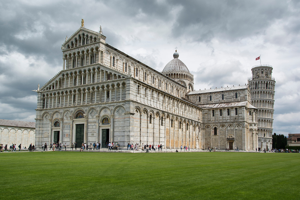 The cathedral and tower on a cloudy day in Pisa.