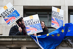 © Licensed to London News Pictures. 14/02/2018. London, UK. Former MP SARAH OLNEY (C) holds an EU flag and placard on the balcony of The Policy Exchange as Foreign Secretary Boris Johnson prepares to give his Valentine's Day 'Liberal Brexit' speech in the same building. Photo credit: Rob Pinney/LNP