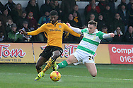 Newport County's Medy Elito challenges for the ball with Yeovil's Conner Roberts. Skybet football league two match, Newport county v Yeovil Town at Rodney Parade in Newport, South Wales on Saturday 21st November 2015.<br /> pic by David Richards, Andrew Orchard sports photography.