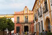 Spanish flag flying on historic buildings in the Alcazar palace area, Seville, Spain