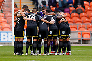Wimbledon players huddle up during the EFL Sky Bet League 1 match between Blackpool and AFC Wimbledon at Bloomfield Road, Blackpool, England on 20 October 2018.