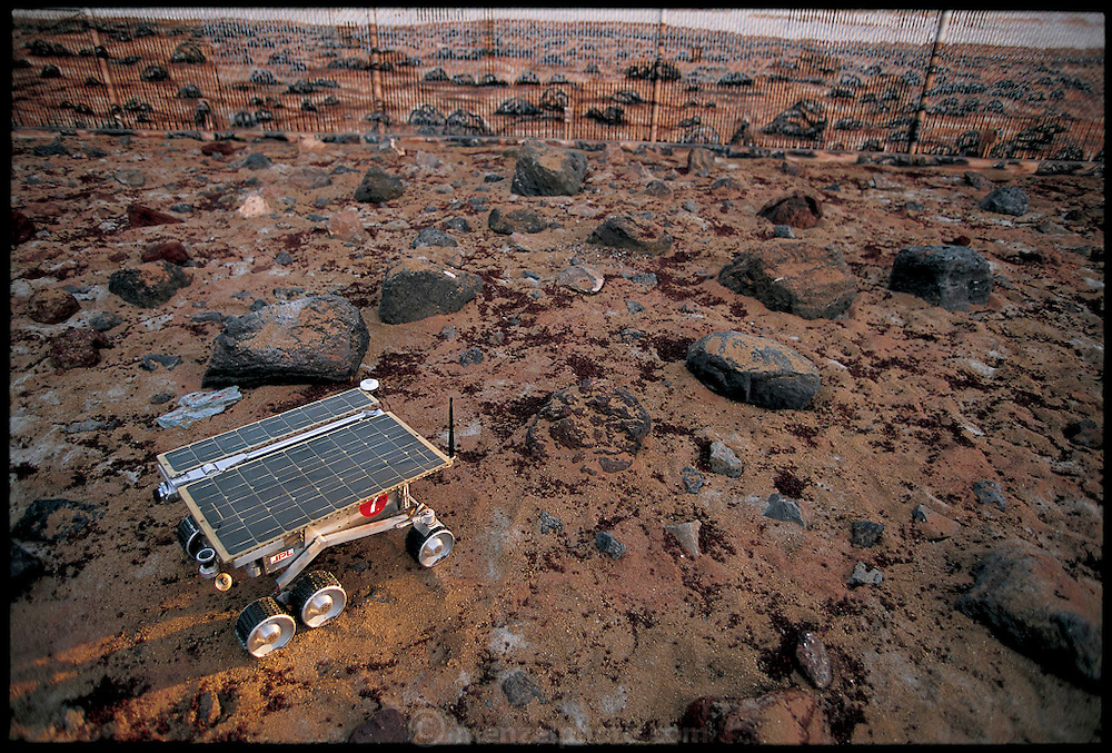 In the fenced Mars Yard at NASA's Jet Propulsion Laboratory in Pasadena, California, the remote-sensing robot Rocky 7 navigates a mock-up of the terrain on the Red Planet. From the book Robo sapiens: Evolution of a New Species, page 122-123.