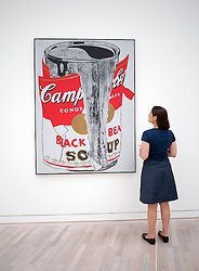 Woman looking at painting Big Torn Campbell's Soup Can (Black Beans) by Andy Warhol at K20  art museum or Kunstsammlung at Grabbeplatz Dusseldorf Germany