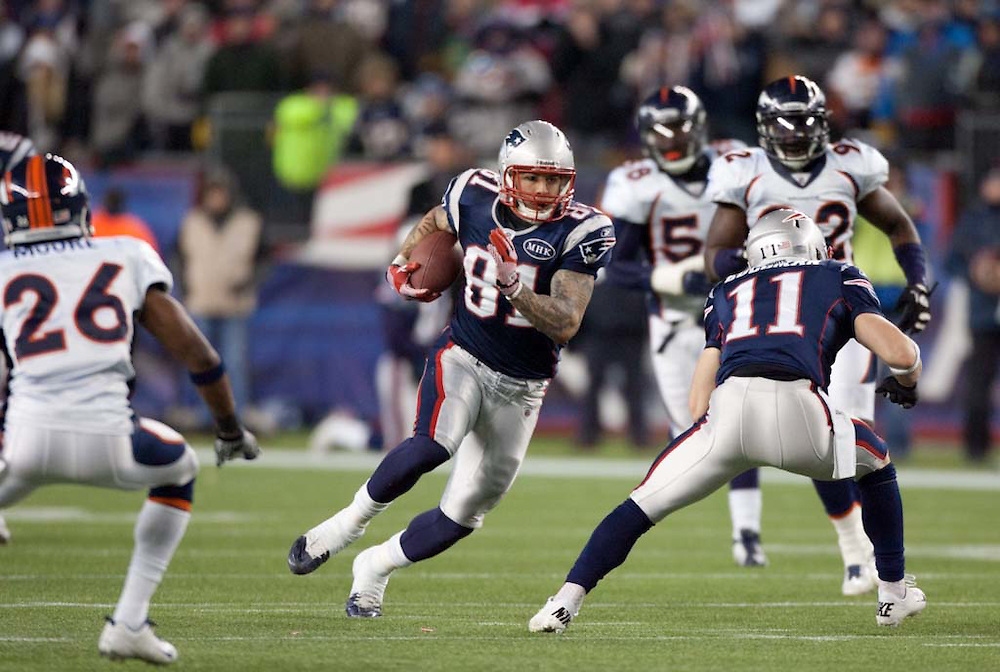 Foxborough, MA 01/14/2012.Patriots tight end Aaron Hernandez rushes in the first half of Saturday's AFC Divisional game between the New England Patriots and the Denver Broncos..Wicked Local Photo by Alex Jones