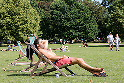 © Licensed to London News Pictures. 24/08/2019. London, UK. A man sunbathes in London's St James's Park as the hot weather continues. According to the Met Office, the temperatures are forecast to reach between 31 and 33 degrees celsius in the south-east of England. <br /> <br /> ***Permission Granted***<br /> <br /> Photo credit: Dinendra Haria/LNP