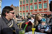 Gent, Belgie, Mar 16, 2009, Mensen genieten van het mooie weer en de terrasjes aan de Graslei,©Christophe VANDER EECKEN