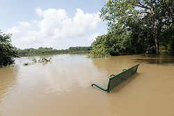 Park bench under flood water at Little Lemon Lake, Great Trinity Forest, Dallas, Texas, USA