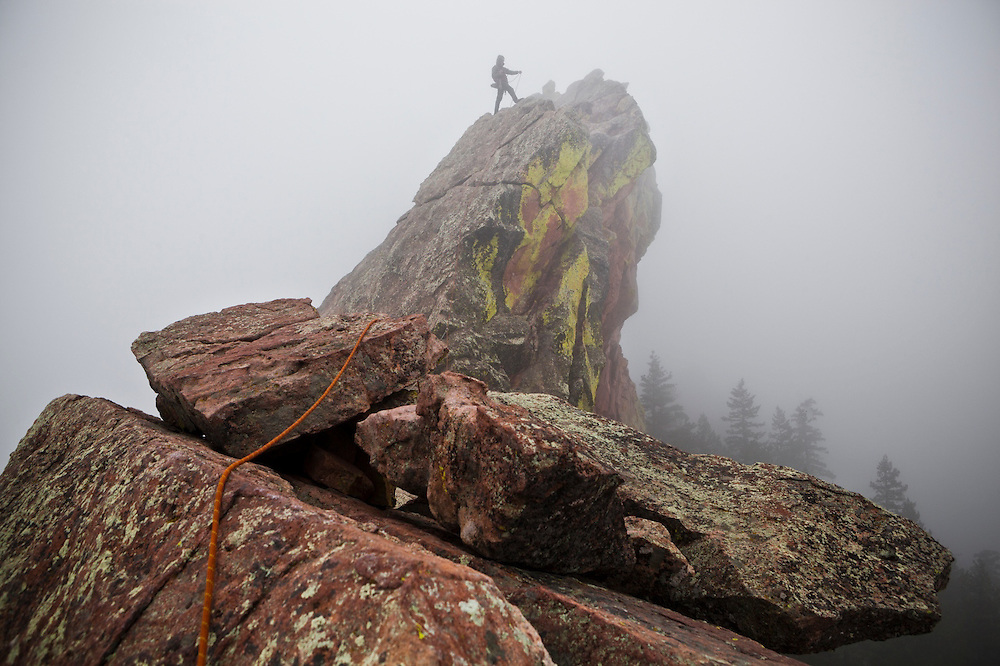 Obadiah Reid belays the photographer up the summit ridge of the First Flatiron (Direct East Face, 5.6) above Boulder, Colorado.