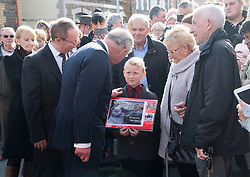 The Prince of Wales meets a young boy in the crowd outside the Aberfan Memorial Garden in Aberfan, Wales on the 50th anniversary of the tragedy.