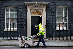 © Licensed to London News Pictures. 06/02/2018. London, UK. A street sweeper cleans the road outside Downing Street this morning. Photo credit : Tom Nicholson/LNP