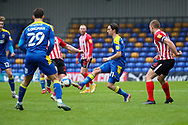 AFC Wimbledon midfielder Ethan Chislett (11) battles for possession during the EFL Sky Bet League 1 match between AFC Wimbledon and Sunderland at Plough Lane, London, United Kingdom on 16 January 2021.