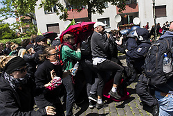 June 17, 2017 - Berlin, Berlin, Germany - Left-wing demonstrators are trying to break through a police barrier. A few hundred sympatizers and activists of the New Right Identity Movement demonstrating in Berlins district Wedding under the motto ''Future Europe - for the defense of our identity, culture and way of life (German: Zukunft Europa – Fuer die Verteidigung unserer Identitaet, Kultur und Lebensweise)'. About 1,500 counter-demonstrators blocked the route of the Identitarian Movement who discontinued their demonstration. According to police, there were several arrests in the course of the blockades. (Credit Image: © Jan Scheunert via ZUMA Wire)