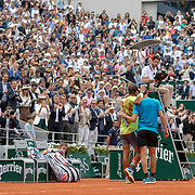 PARIS, FRANCE June 09.  Rafael Nadal of Spain after winning his twelfth French Open title embraces Dominic Thiem of Austria after the Men's Singles Final on Court Philippe-Chatrier at the 2019 French Open Tennis Tournament at Roland Garros on June 9th 2019 in Paris, France. (Photo by Tim Clayton/Corbis via Getty Images)