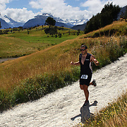 A competitor in action during the run leg of the Paradise Triathlon and Duathlon series with breathtaking views of Mount Aspiring National Park, Paradise, Glenorchy, South Island, New Zealand. 18th February 2012. Photo Tim Clayton