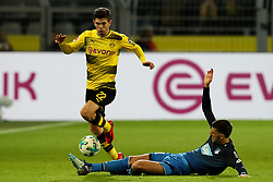 DORTMUND, Dec. 17, 2017  Florian Grillitsch of Hoffenheim and  Christian Pulisic (L) of Dortmund battle for the ball during the Bundesliga match between Borussia Dortmund and TSG 1899 Hoffenheim at Signal Iduna Park on December 16, 2017 in Dortmund, Germany. Dortmund won 2-1. (Credit Image: © Joachim Bywaletz/Xinhua via ZUMA Wire)