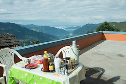 Breakfast table on the roof of a lodge, Nepal