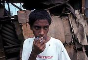 Boy sniffing glue, Managua's eastern market