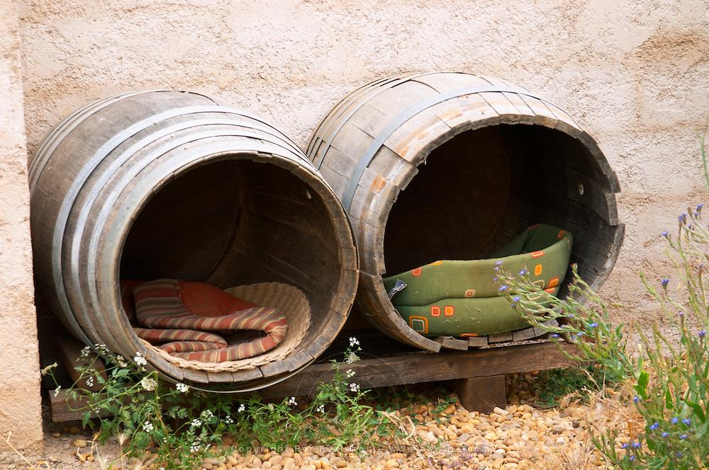 Domaine de la Garance. Pezenas region. Languedoc. Wine barrels made into a dog house. France. Europe.