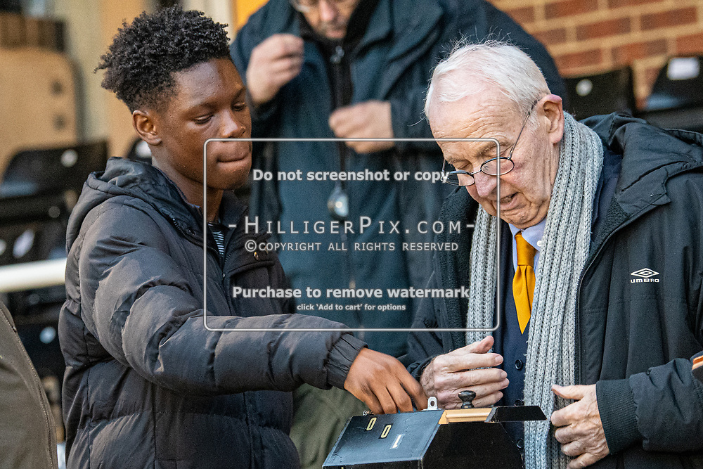 BROMLEY, UK - DECEMBER 07: Emmanuel, from the Cray Wanderers U18's makes the 100 Club draw during half time of the BetVictor Isthmian Premier League match between Cray Wanderers and Potters Bar Town at Hayes Lane on December 7, 2019 in Bromley, UK. <br /> (Photo: Jon Hilliger)