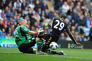 Aston Villa keeper Brad Guzan saves from Chelsea's Demba Ba. Barclays Premier League, Aston Villa v Chelsea at Villa Park in Birmingham on Saturday 11th May 2013. pic by Andrew Orchard,  Andrew Orchard sports photography,