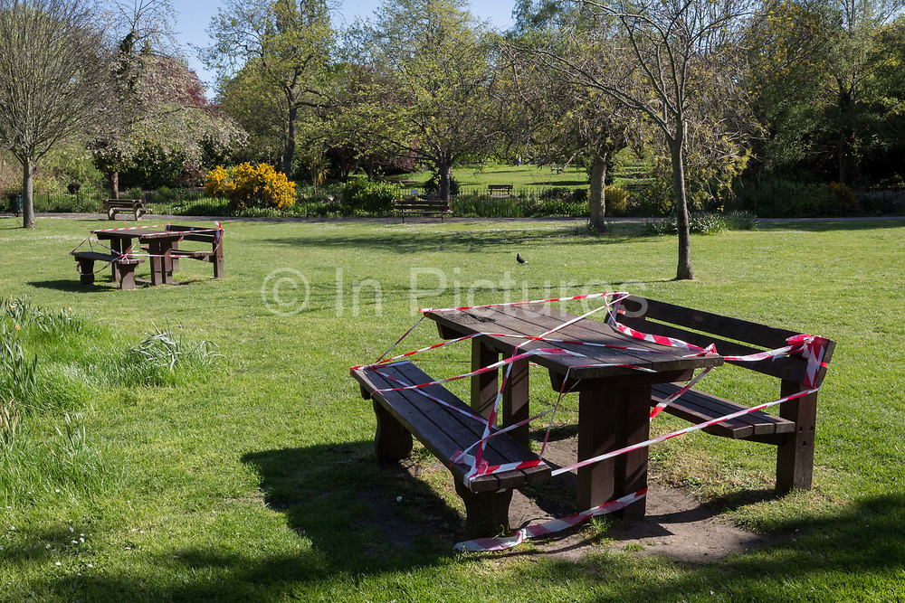 At the beginning of the fourth week of the UK governments lockdown during the Coronavirus pandemic, and with 120,067 UK reported cases with 16,060 deaths, taped off benches remain vacant in Ruskin Park, a green space in Lambeth, South London, on 20th April 2020, in London, England.
