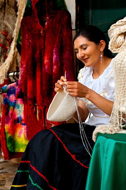 Colombia, Villa de Leyva, Boyaca Province, Colonial Town, Traditional Hat Knitter, Real Fabrica de Licores Colonial Museum