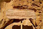 Prehistoric  Rock art in the desert depicting a Jewish Menorah near a Roman mine, Timna natural and historic park, Israel,